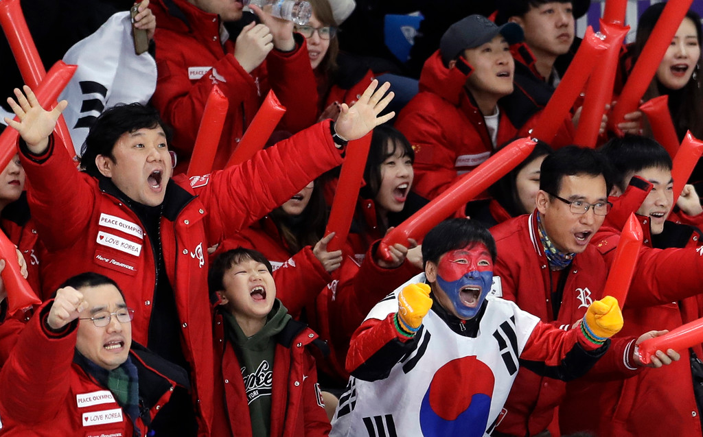 . South Koreans celebrate as their fellow countryman Lee Seung-hoon competes during the men\'s 10,000 meters speedskating race at the Gangneung Oval at the 2018 Winter Olympics in Gangneung, South Korea, Thursday, Feb. 15, 2018. (AP Photo/Petr David Josek)