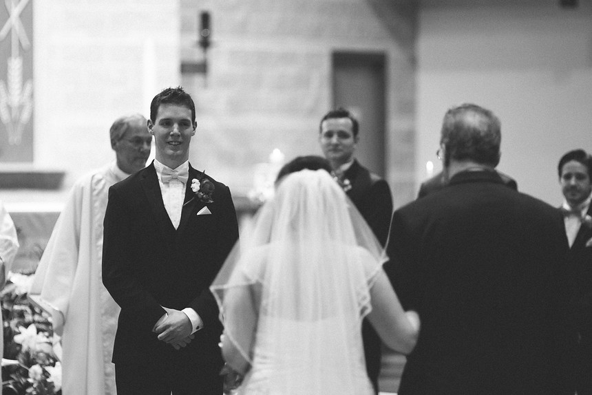 groom sees bride walking down the aisle