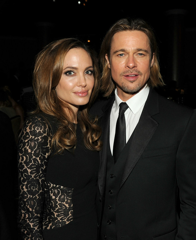 . Actress/producer Angelina Jolie (L) and actor Brad Pitt attend the 23rd annual Producers Guild Awards at The Beverly Hilton hotel on January 21, 2012 in Beverly Hills, California.  (Photo by Kevin Winter/Getty Images For PGA)