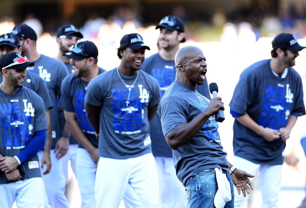 . Actor Terry Crews joins in the fun as the Dodgers\' hold a post game rally after their final game of the regular season Sunday, September 29, 2013. (Photo by Sarah Reingewirtz/Pasadena Star-News)