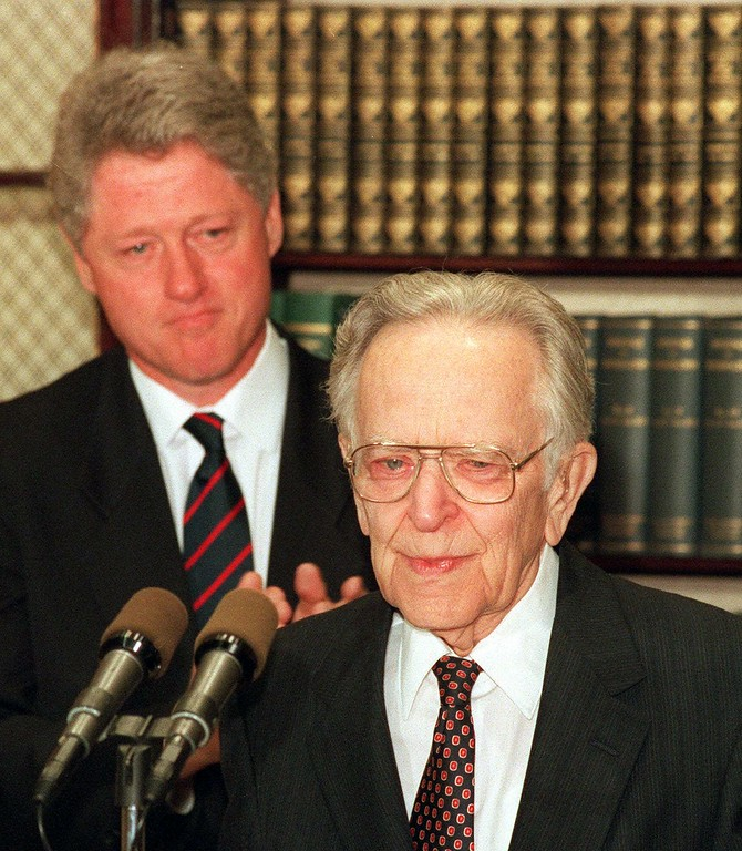 . President Clinton looks on as retiring Supreme Court Justice Harry Blackmun addresses reporters in this Wednesday, April 6, 1994 photo. (AP Photo/Marcy Nighswander)