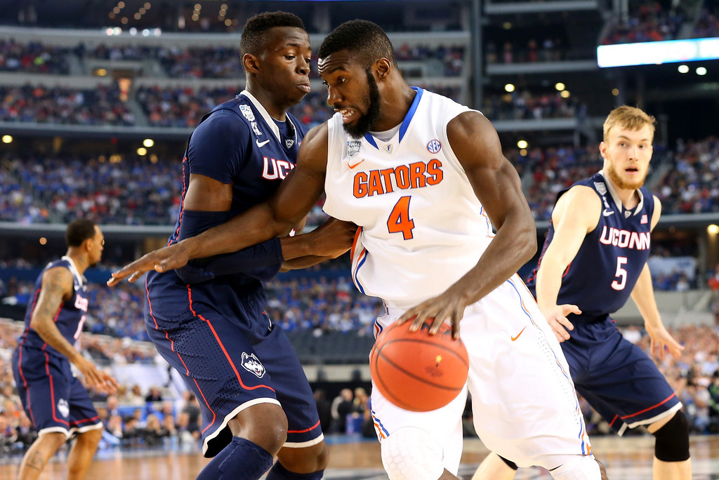 . ARLINGTON, TX - APRIL 05: Patric Young #4 of the Florida Gators drives to the basket as Amida Brimah #35 of the Connecticut Huskies defends during the NCAA Men\'s Final Four Semifinal at AT&T Stadium on April 5, 2014 in Arlington, Texas.  (Photo by Ronald Martinez/Getty Images)