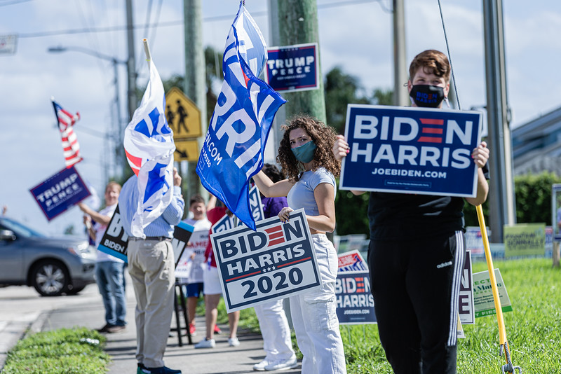 Supporters of Vice President Joe Biden and President Donald J. Trump stand along Lantana Road waving flags and brandishing signs in front of the Lantana Road Branch Library in Lake Worth on Election Day, November 3, 2020. (JOSEPH FORZANO / THE PALM BEACH POST)