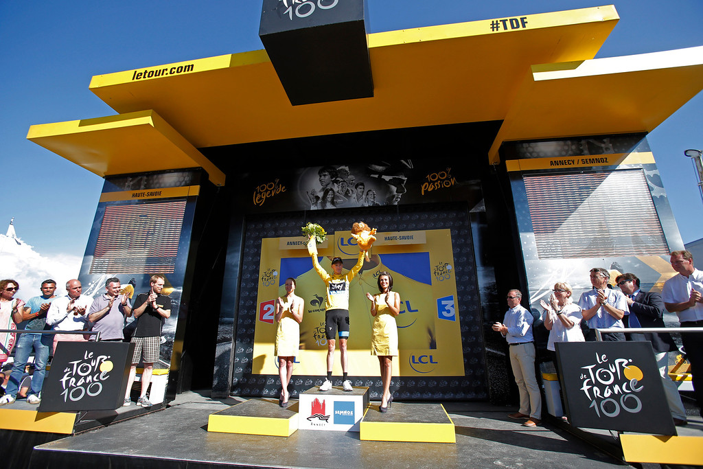 . Christopher Froome of Britain, wearing the overall leader\'s yellow jersey, celebrates on the podium of the 20th stage of the Tour de France cycling race over 125 kilometers (78.1 miles) with start in in Annecy and finish in Annecy-Semnoz, France, Saturday July 20 2013. (AP Photo/Christophe Ena)