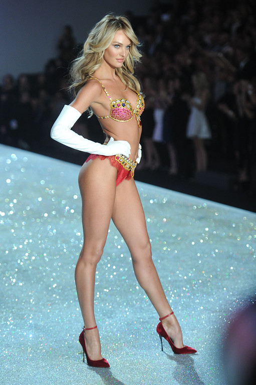 . Model Candice Swanepoel walks the runway at the 2013 Victoria\'s Secret Fashion Show at Lexington Avenue Armory on November 13, 2013 in New York City.  (Photo by Jamie McCarthy/Getty Images)