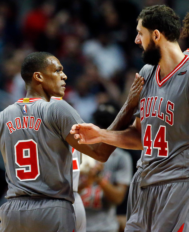 . Chicago Bulls guard Rajon Rondo, left, celebrates with forward Nikola Mirotic after scoring a basket during the second half of an NBA basketball game against the Cleveland Cavaliers Thursday, March 30, 2017, in Chicago. The Bulls won 99-93. (AP Photo/Nam Y. Huh)