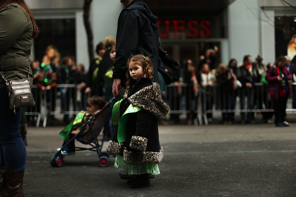 . A young girl pauses as she makes her way up 5th Avenue during New York City\'s St. Patrick\'s Day Parade on March 17, 2015 in New York City. Despite a policy shift that will allow a gay group to march for the first time in the parade\'s history, New York Mayor Bill de Blasio has refused to march in the city\'s parade. Tuesday\'s parade saw the first openly gay group, OUT@NBCUniversal, marching under its own banner.  (Photo by Spencer Platt/Getty Images)