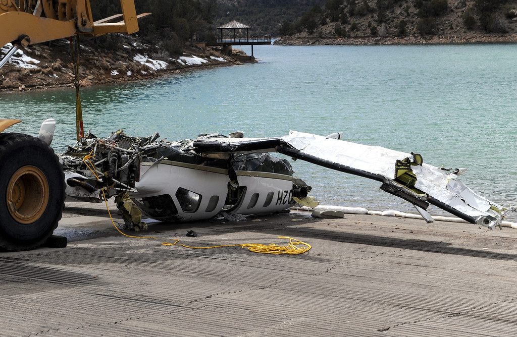 . Ouray County released this photo that shows  the aircraft being pulled onto a dock after it was recovered with the five victims on Thursday March 27, 2014, at the Ridgway Reservoir near Ridgway, Colo.,  The plane crashed last Saturday, March 22, 2014, killing five people from Alabama. (AP Photo/Ouray County, William Woody)