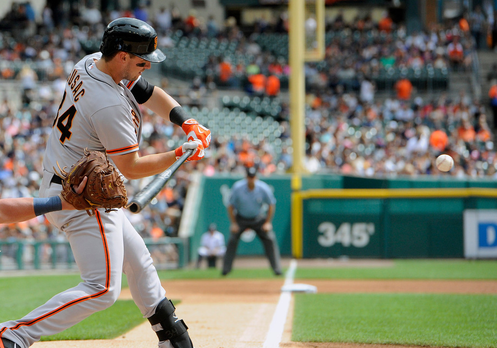 . San Francisco Giants� Andrew Susac hits a two run double against the Detroit Tigers in the first inning of a baseball game Saturday, Sept. 6, 2014, in Detroit, Mich.  AP Photo/Jose Juarez)