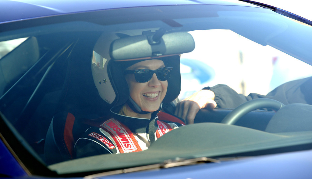. Rosamond, Calif., -- 03-23-13-  Toyota Pro/ Celebrity Race participant Jenna Elfman prepares for a practice session at Willow Springs Raceway. The Toyota Pro/Celebrity Race helps raise money on behalf of Racing for Kids, a fundraising program benefiting Miller Children�s Hospital in Long Beach and Children�s Hospital of Orange County. On behalf of the race and its participants, Toyota has donated more than $2 million to various children�s hospitals since 1991.  Stephen Carr/  Los Angeles Newspaper Group