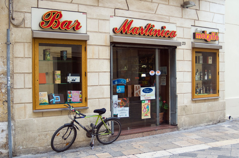 Street Scene with Bicycle and Bar Windows, Corso Vittorio Emanuele II, Lecce, Apulia (Puglia), Southern Italy