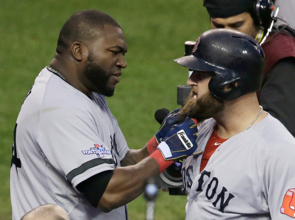 . Boston Red Sox\'s David Ortiz pulls on the beard of Mike Napoli after Napoli hits a home run in the seventh inning during Game 3 of the American League baseball championship series against the Detroit Tigers Tuesday, Oct. 15, 2013, in Detroit. (AP Photo/Carlos Osorio)
