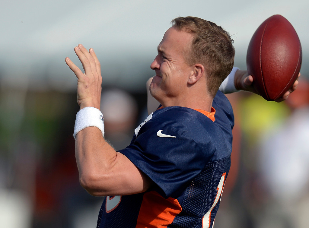 . Denver Broncos QB Peyton Manning (18) warms up  during training camp August 1, 2013 at Dove Valley. (Photo By John Leyba/The Denver Post)