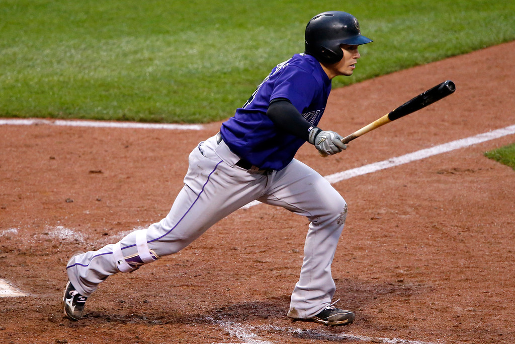 . Colorado Rockies\' Tony Wolters drives in a run with a single off Pittsburgh Pirates relief pitcher Mark Melancon in the ninth inning of a baseball game in Pittsburgh, Saturday, May 21, 2016. A second run scored on the play due to an error by Pirates first baseman John Jaso. The Rockies won 5-1. (AP Photo/Gene J. Puskar)