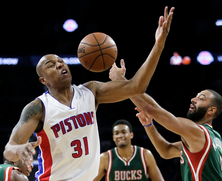. Detroit Pistons\' Caron Butler (31) has the ball knocked away by Milwaukee Bucks\' Kendall Marshall during the second half of an NBA basketball game Friday, Nov. 7, 2014, in Auburn Hills, Mich. The Pistons defeated the Bucks 98-95. (AP Photo/Duane Burleson)