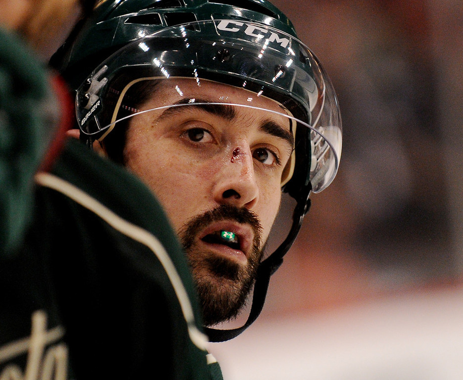 . Minnesota right wing Cal Clutterbuck, sporting a fresh nose wound, takes a break on the bench in the third period against Chicago. (Pioneer Press: John Autey)