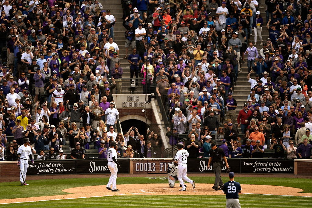 . Denver, CO - ARRIL 08: Trevor Story (27) of the Colorado Rockies lands on home plate after hitting his 5th home run in the 4th inning of their home opening loss 13-6 to the San Diego Padres at Coors Field. April 08, 2016 in Denver, CO. (Photo By Joe Amon/The Denver Post)