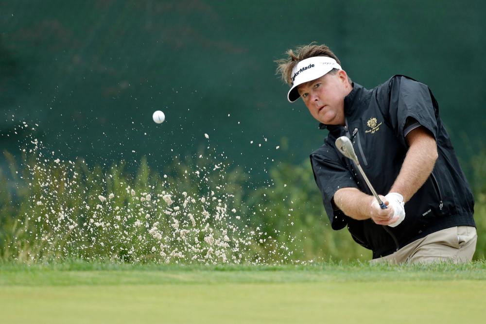 . John Nieporte hits out of a bunker on the seventh hole during the first round of the U.S. Open golf tournament at Merion Golf Club, Friday, June 14, 2013, in Ardmore, Pa. (AP Photo/Julio Cortez)