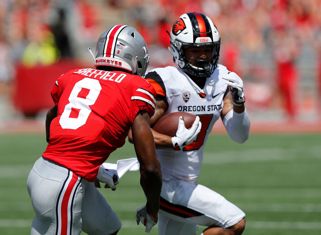. Oregon State wide receiver Trevon Bradford, right, tries to outrun Ohio State defensive back Kendall Sheffield during the first half of an NCAA college football game Saturday, Sept. 1, 2018, in Columbus, Ohio. (AP Photo/Jay LaPrete)