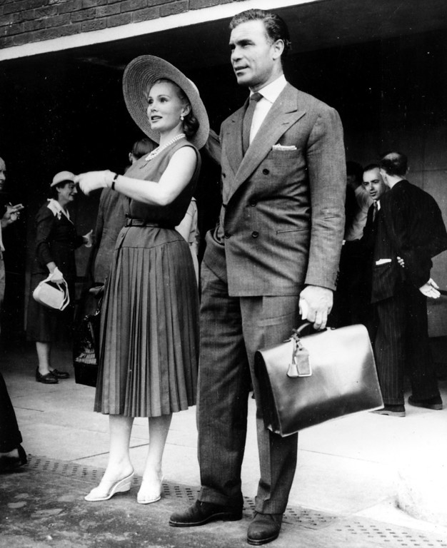. American actress Zsa Zsa Gabor, left, and Porfirio Rubirosa, Dominican ambassador to Paris, are shown at London Airport after arriving from Paris on July 14, 1955.  (AP Photo)