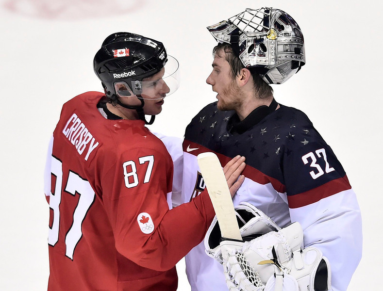 . Sidney Crosby of Canada, left, greets goaltender Jonathan Quick of the United States after Canada beat the USA 1-0 in a men\'s semifinal ice hockey game at the 2014 Winter Olympics, Friday, Feb. 21, 2014, in Sochi, Russia. (AP Photo/The Canadian Press, Nathan Denette)