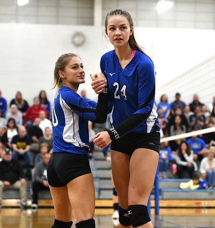 10/23/2019 Mike Orazzi | StaffrBristol Eastern's Lucy Winiarski (20) and Sage Scarritt (24) against RHAM during girls volleyball at Bristol Eastern on Wednesday night. rr