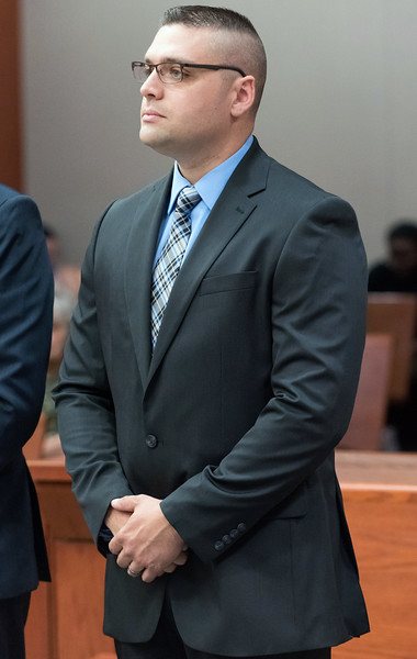 07/10/18  Wesley Bunnell   Staff  Former New Britain and current Rocky Hill Police Officer Jacob Boucher stands in New Britain Superior Court on Tuesday morning. Boucher was arrested last week regarding a June 30 incident in New Britain.