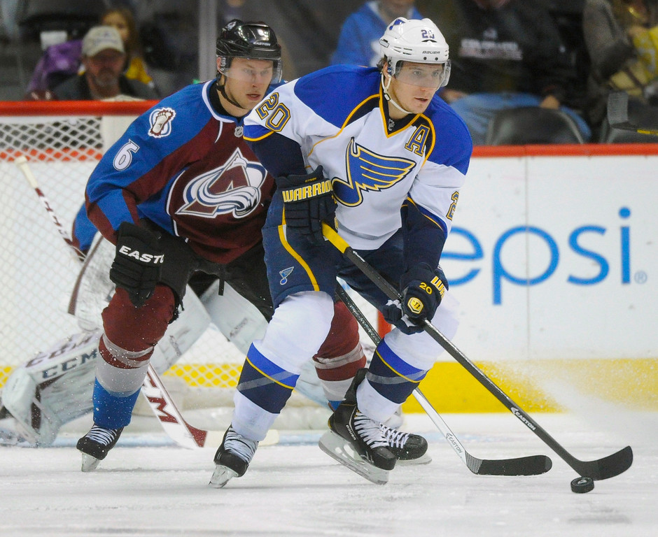 . St. Louis wing Alexander Steen (20) took a pass in front of Avalanche defenseman Erik Johnson (6) in the first period. The Colorado Avalanche hosted the St. Louis Blues at the Pepsi Center Wednesday night, November 27, 2013.  Photo By Karl Gehring/The Denver Post