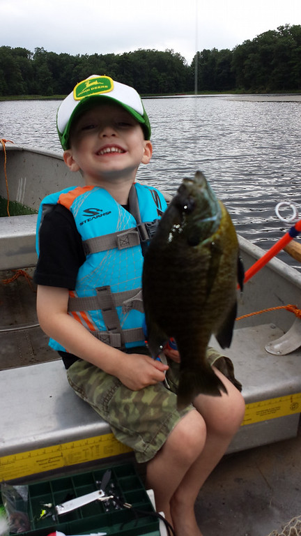 . Jonas Sparr, 3, of Shoreview caught his first fish on his first cast with a worm on Silver Lake in Polk County, Wis., earlier this summer. (Courtesy Peter Sparr)