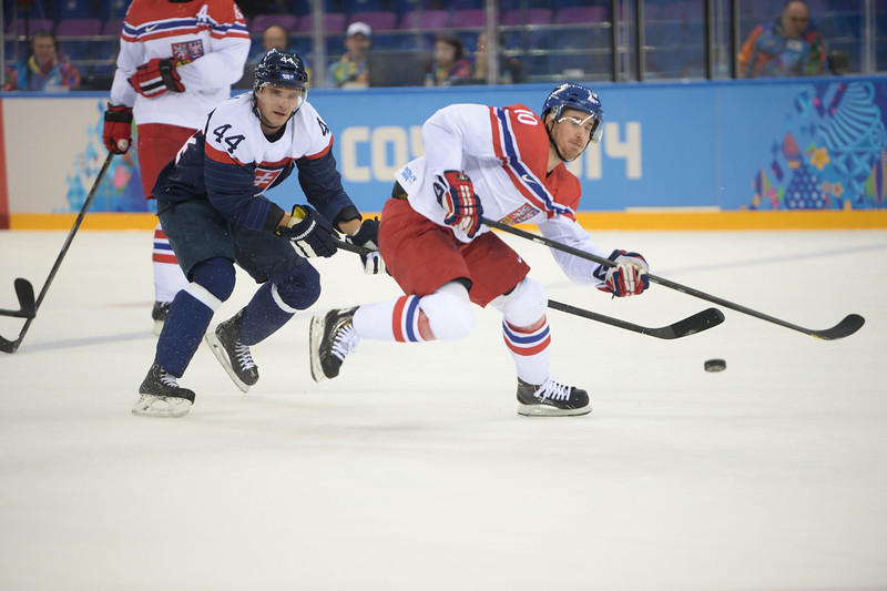 . Czech\'s Roman Cervenka (R) vies with Slovakia\'s Andrej Sekera (L) during the Men\'s Ice Hockey Play-offs Czech Republic vs Slovakia at the Shayba Arena during the Sochi Winter Olympics on February 18, 2014.  (JUNG YEON-JE/AFP/Getty Images)