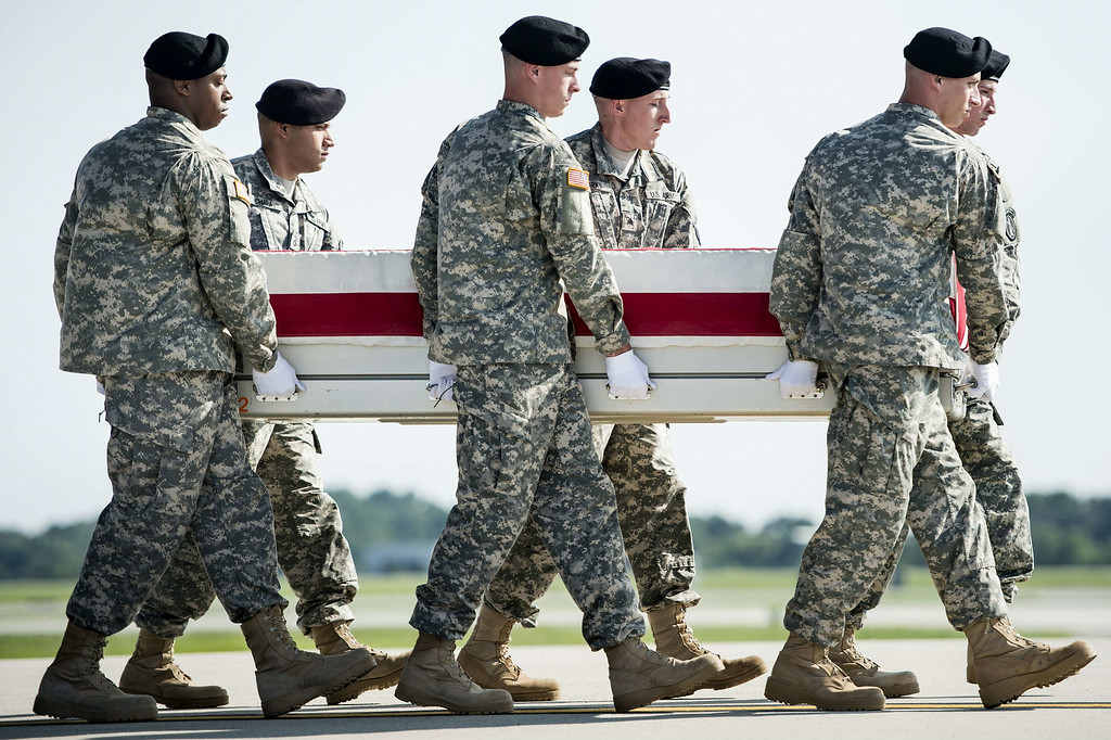 . A US Army carry team moves a transfer case with the remains of US Army Maj. Gen. Harold J. Greene from a C-17 cargo plane during a dignified transfer at Dover Air Force Base August 7, 2014 in Delaware. Major General Harold J. Greene was shot dead on August 5, 2014 at a training center in Kabul in an attack that left more than a dozen others wounded, including a senior German officer. AFP PHOTO/Brendan SMIALOWSKI/AFP/Getty Images