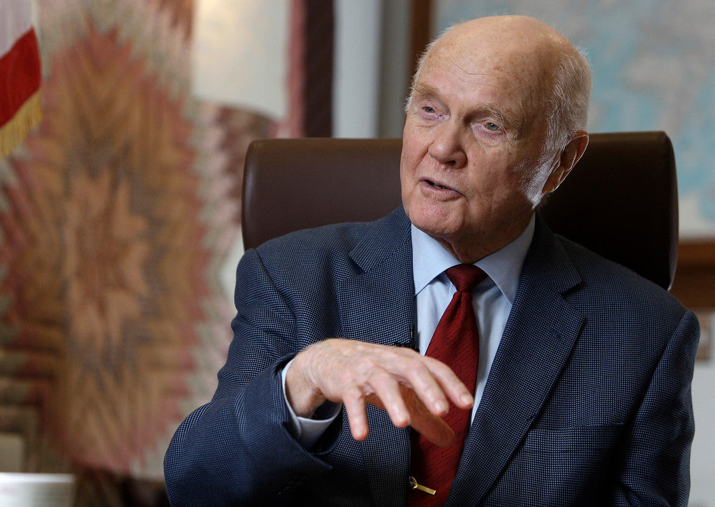 . In this Jan. 25, 2012 photo, Sen. John Glenn speaks during an interview at his office in Columbus, Ohio. Glenn was the first American to orbit Earth, piloting Friendship 7 around the planet three times in 1962. Glenn, as a U.S. senator at age 77, also became the oldest person in space by orbiting Earth with six astronauts aboard shuttle Discovery in 1998. (AP Photo/Jay LaPrete)