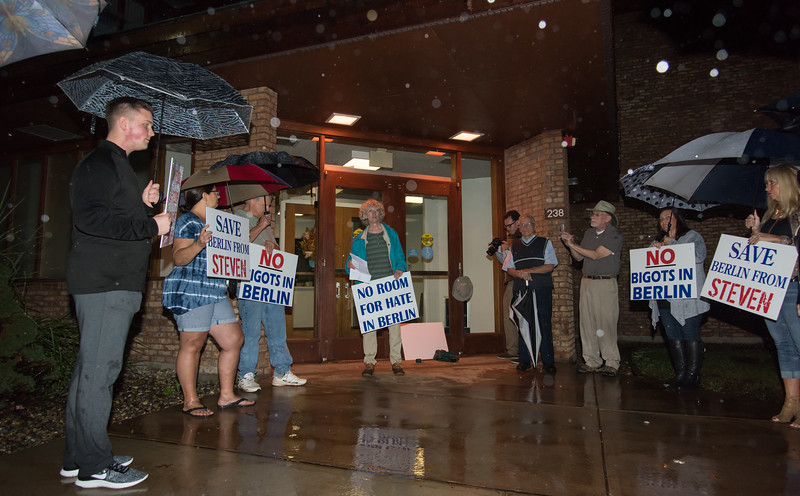 10/11/18  Wesley Bunnell | Staff  17 protestors stood outside of the Berlin Board of Education Department on Thursday evening to protest comments made by Republican candidate for the 30th district Steven Baleshiski. Barbara Coughlin, middle, kicked off one of several speeches from the crowd as fellow protestors listen.
