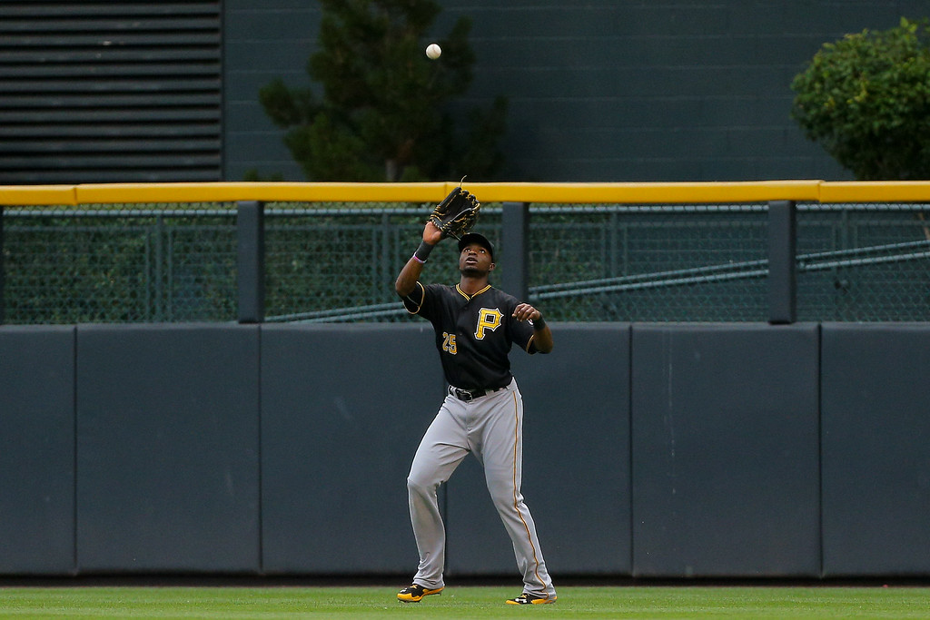 . Right fielder Gregory Polanco #25 of the Pittsburgh Pirates makes a catch for the first out of the first inning on a ball off the bat of Charlie Blackmon (not pictured) of the Colorado Rockies at Coors Field on July 25, 2014 in Denver, Colorado. (Photo by Justin Edmonds/Getty Images)
