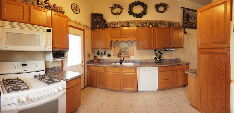 Large pantry with plenty of storage, new countertops!