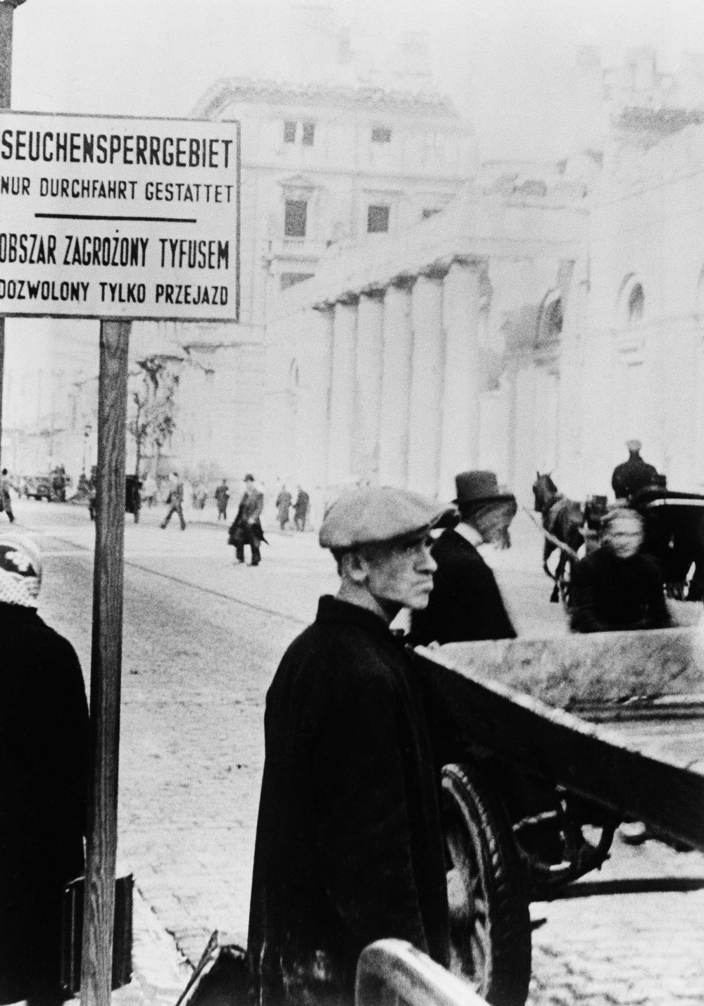 """. Sign at the entrance to the Jewish Ghetto in Warsaw Plague reads: \""""Barred section only through fare permitted\"""", Feb. 10, 1941, Warsaw, Poland.  (AP Photo)"""