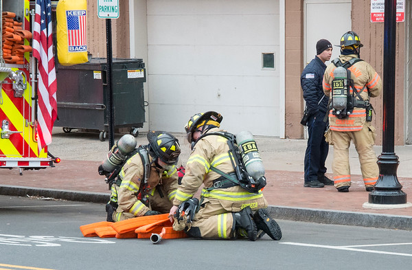 01/31/20 Wesley Bunnell | StaffrrA fire occurred at 40 Chestnut St on Friday afternoon January 31, 2020 requiring one person to be taken by ambulance for smoke inhalation. Fire fighters prepare to load hose back on Engine 2.