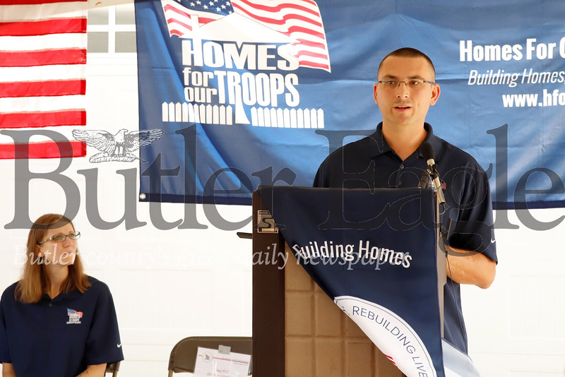 U.S. veteran Justin Hendrickson expresses his gratitude for the home he and his wife Jennie(left) recieved from Homes for Troops Saturday 08/03/12. Hendrickson lost a leg serving in Iraq and his wife is a brain cancer survivor. Residents, family, friends and local veteran motorcycle clubs should up in force for the ceremony honoring Hendrickson and awarding he and his wife the home. Seb Foltz/Butler Eagle