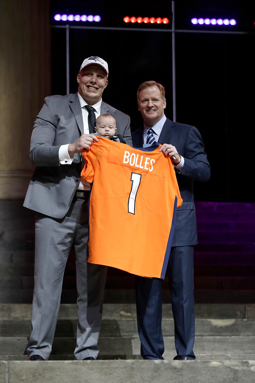 . Utah\'s Garett Bolles, left, and son, Kingston, pose with NFL commissioner Roger Goodell after being selected by the Denver Broncos during the first round of the 2017 NFL football draft, Thursday, April 27, 2017, in Philadelphia. (AP Photo/Matt Rourke)
