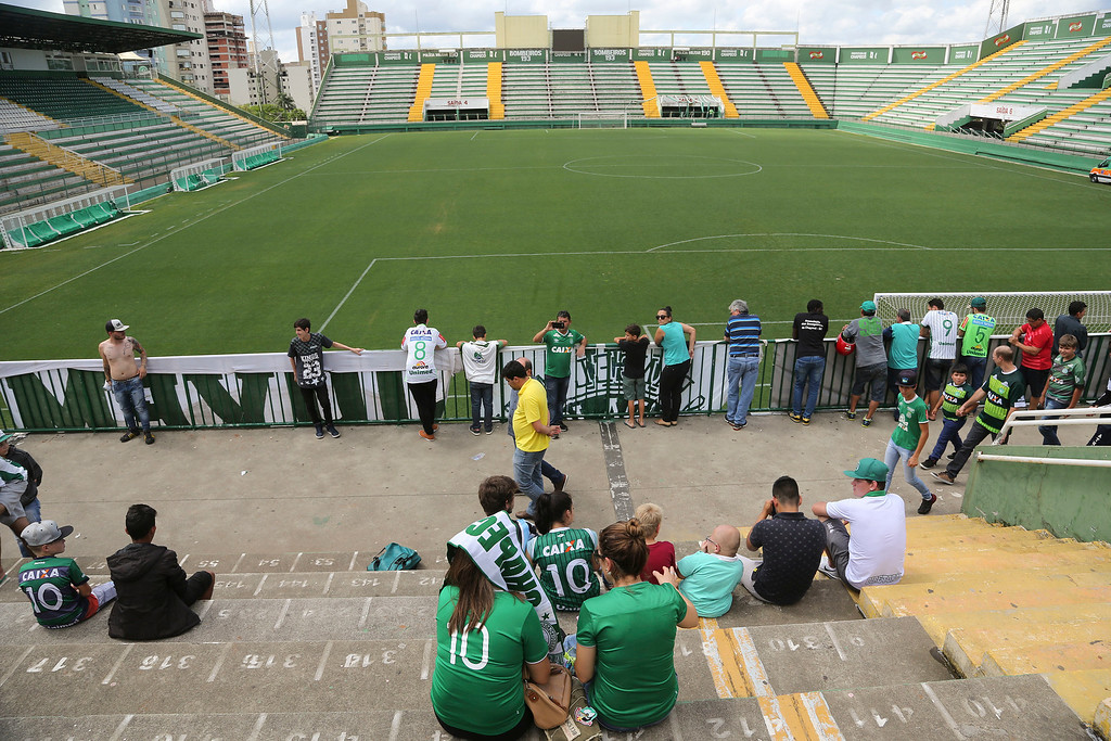 . Fans of Brazil\'s soccer team Chapecoense gather outside the Arena Conda stadium in Chapeco, Brazil, Tuesday, Nov. 29, 2016. A chartered plane that was carrying the Brazilian soccer team to the biggest match of its history crashed into a Colombian hillside and broke into pieces, killing 75 people and leaving six survivors, Colombian officials said Tuesday. (AP Photo/Andre Penner)