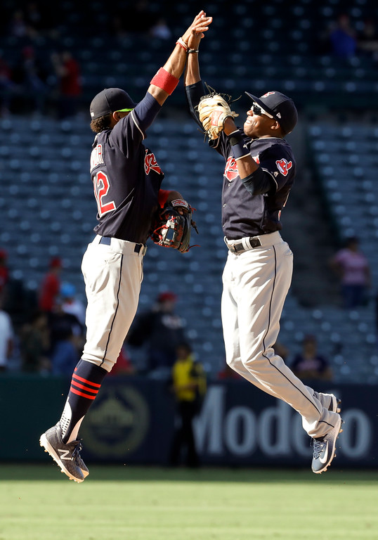 . Cleveland Indians shortstop Francisco Lindor, left, celebrates with center fielder Greg Allen after the teams win against the Los Angeles Angels during a baseball game in Anaheim, Calif., Thursday, Sept. 21, 2017. (AP Photo/Chris Carlson)