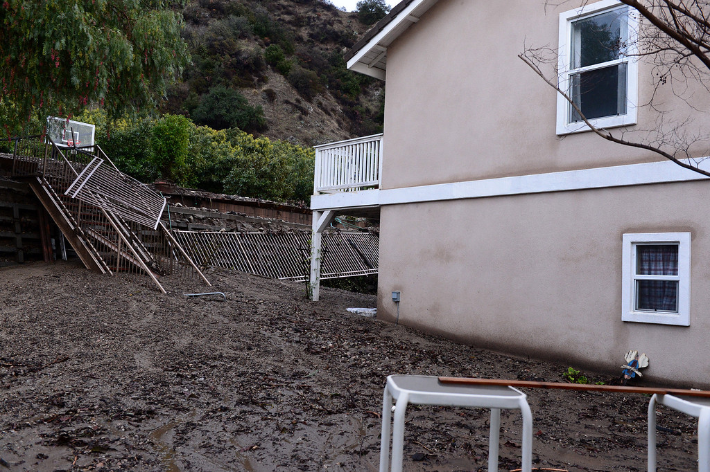 . A home\'s backyard on Ridge View Drive in Azusa is buried in mud Saturday, March 1, 2014. The neighborhood sits below the Colby Fire burn area. (Photo by Sarah Reingewirtz/Pasadena Star-News)