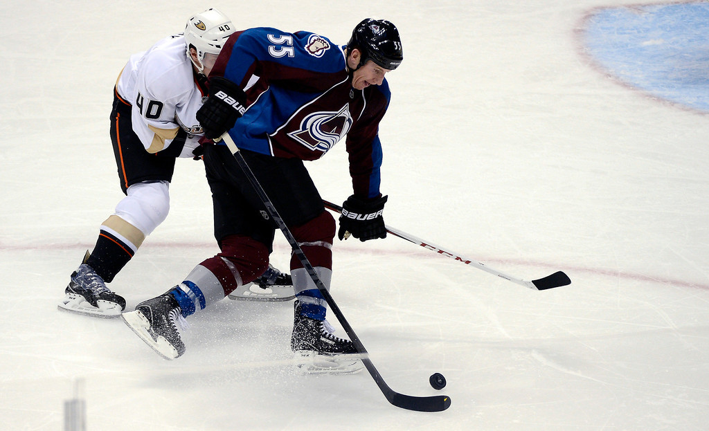 . DENVER, CO. - FEBRUARY 06: Cody McLeod (55) of the Colorado Avalanche skates with the puck away from Jordan Hendry (40) of the Anaheim Ducks during the second period February 6, 2013 at Pepsi Center. The Colorado Avalanche take on the Anaheim Ducks during NHL action. (Photo By John Leyba / The Denver Post)