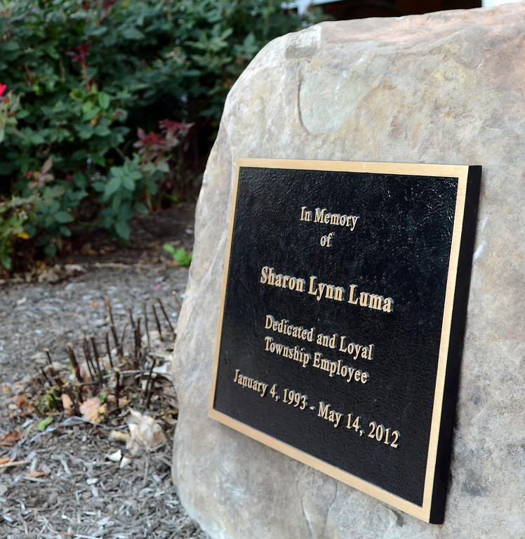 . The  memorial stone and plaque dedicated to Sharon Luma, a former assistant to the Towamencin Township manager,who was killed in a motorcycle accident. Wednesday August 27,2014. Photo by Mark C Psoras/The Reporter