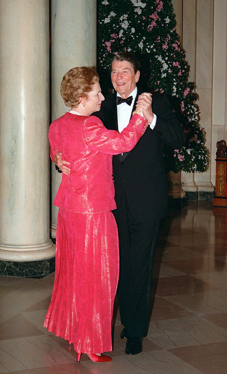 """. A picture dated November 16, 1988 shows then British Prime Minister Margaret Thatcher dancing with then US President Ronald Reagan following a state dinner given in her honor at the White House. Former British prime minister Margaret Thatcher, the \""""Iron Lady\"""" who shaped a generation of British politics, died following a stroke on April 8, 2013 at the age of 87, her spokesman said. M. SPRAGUE/AFP/Getty Images"""