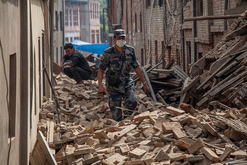 . A member of police forces walk down a street covered in debris after buildings collapsed on April 26, 2015 in Bhaktapur, Nepal. A major 7.8 earthquake hit Kathmandu mid-day on Saturday, and was followed by multiple aftershocks that triggered avalanches on Mt. Everest that buried mountain climbers in their base camps. Many houses, buildings and temples in the capital were destroyed during the earthquake, leaving thousands dead or trapped under the debris as emergency rescue workers attempt to clear debris and find survivors.  (Photo by Omar Havana/Getty Images)