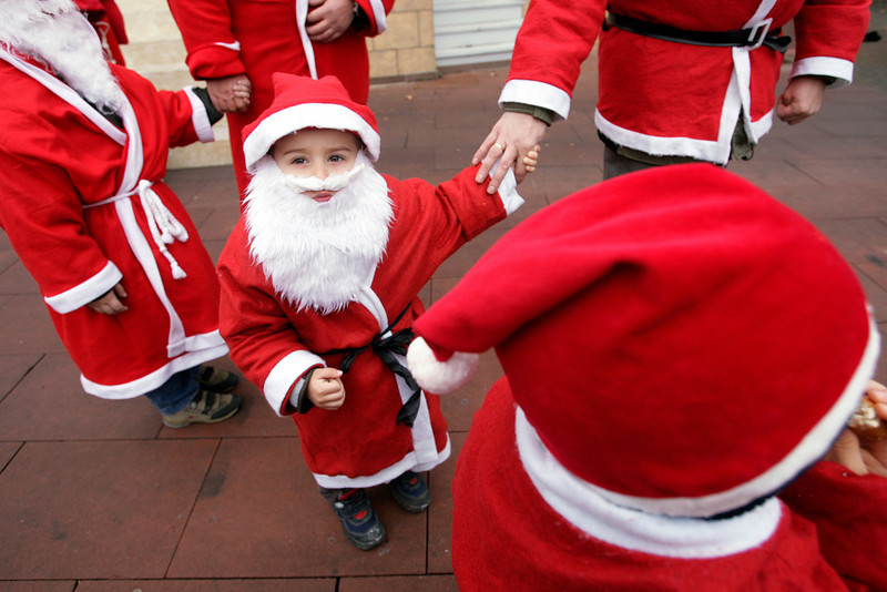 . Children dressed as Santa Klaus walk around the entertainment park Europa in the southern German village of Rust 01 December 2007. As soon as the Christmas decorations come out of storage, the perennial German debate heats up -- to shop or not to shop on Sundays? While most of western Europe allowed stores to open on Sunday years ago, it remains a highly sensitive issue in Germany. AFP PHOTO /  OLIVIER MORIN