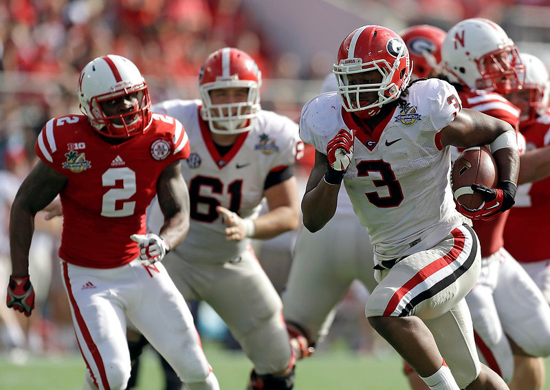 . Georgia running back Todd Gurley (3) runs for a 24-yard touchdown past the Nebraska defense during the first half of the Capital One Bowl NCAA football game, Tuesday, Jan. 1, 2013, in Orlando, Fla. (AP Photo/John Raoux)