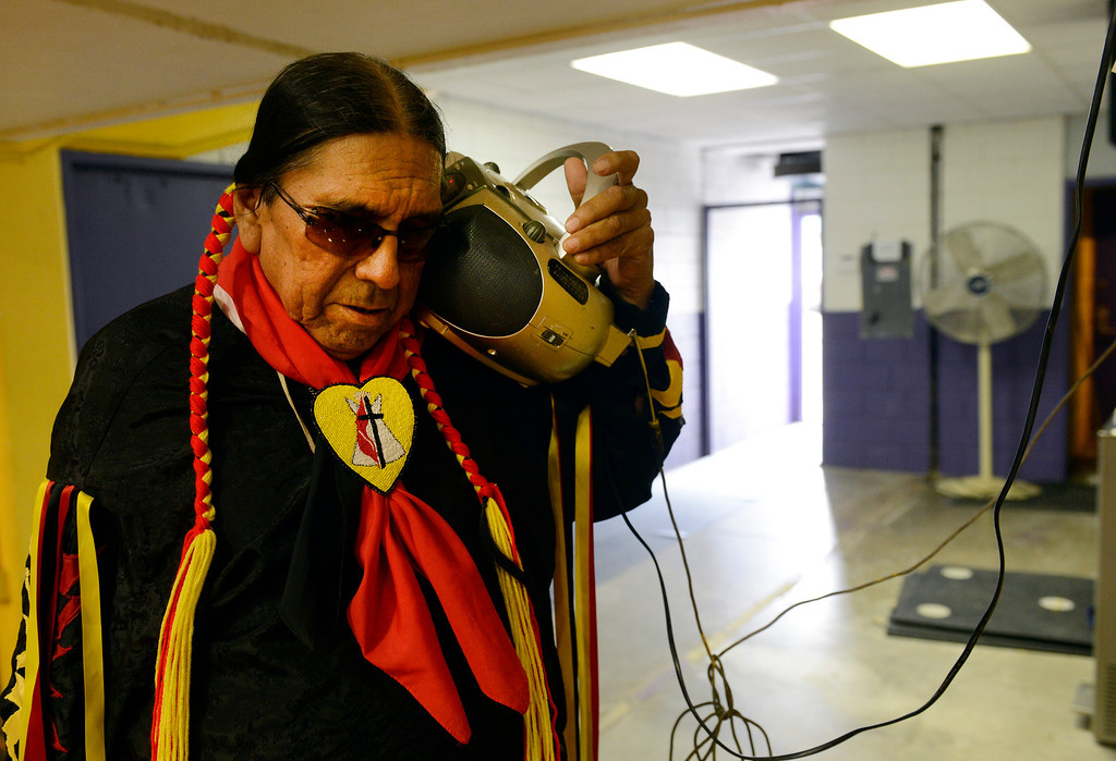 . Kiowa Indian, Tom Ware, master of ceremonies for the 22nd annual Sand Creek Descendants Gathering in Anadarko Oklahoma, listens intently to the 4A Oklahoma State high school football championship between the Anadarko Warriors and the Clinton Red Tornadoes Saturday, December 1st, 2012. Anadarko lost 21-14. Nearly 100 descendants of the Sand Creek Massacre gathered at the Anadarko High School gym for traditional Gourd dancing, food and other activities and also to get updates on legal action towards the U.S. for the massacre which left over 150 Cheyenne and Arapaho Indians dead in southeast Colorado November 29th, 1864. (Andy Cross/The Denver Post)