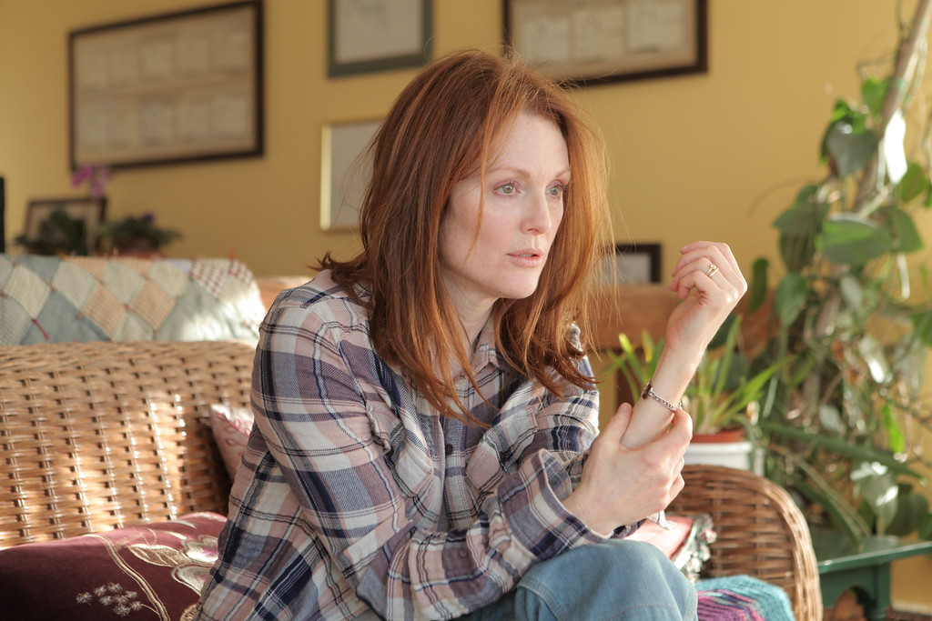 """. In this image released by Sony Pictures Classics, Julianne Moore appears in a scene from the film, \""""Still Alice.\"""" Moore was nominated for a Golden Globe for best actress in a drama for her role in the film on Thursday, Dec. 11, 2014. The 72nd annual Golden Globe awards will air on NBC on Sunday, Jan. 11. (AP Photo/Sony Pictures Classics, Linda Kallerus)"""